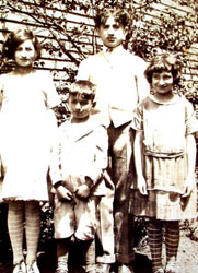 Cappi (right) as a young child with her brothers and sister