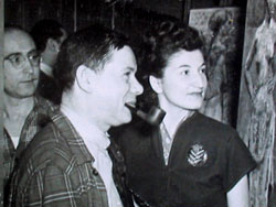 Cappi with Robert Brackman, looking at some of her paintings